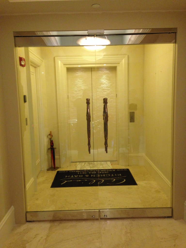 View to elevator & Residence - Chrome Glass Doors / Magnetic Locking | Dash Door